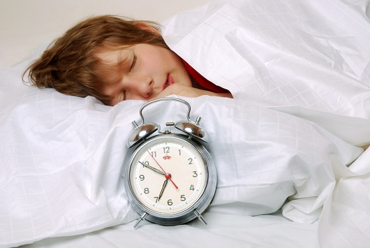 Boy sleeping clock