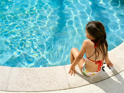Swimming pool girl on side