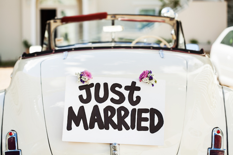 """""""Just Married"""" Sign Attached On Car's Trunk"""