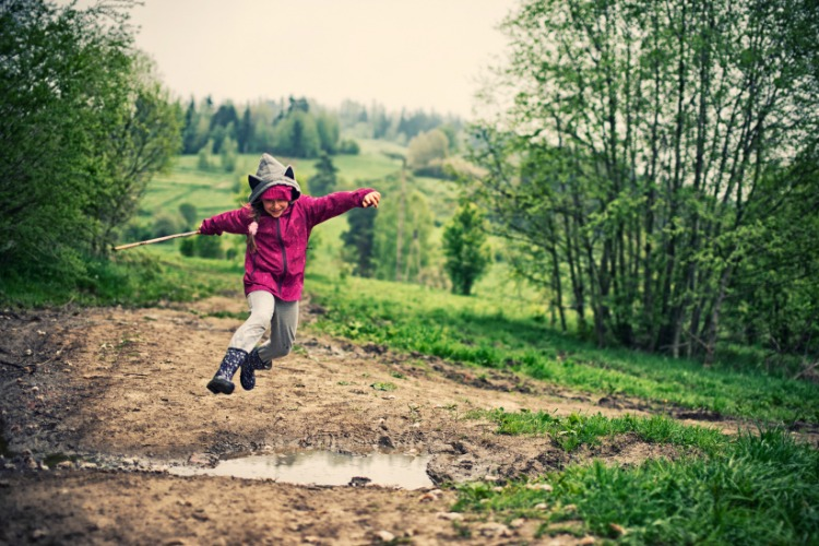 kid jumping hiking walking outisde nature