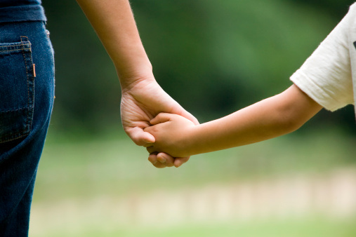 mother-son-holding-hands-jpg
