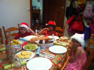 Jo Abi's kids enjoying one of their 7 Christmas dinners.